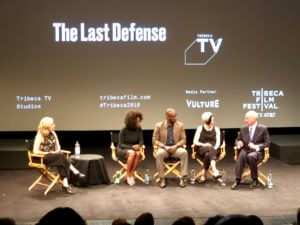 The cast of The Last Defense being interviewed on stage